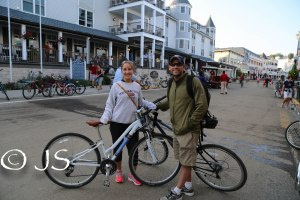 Brad and I with our bikes downtown Mackinac Island